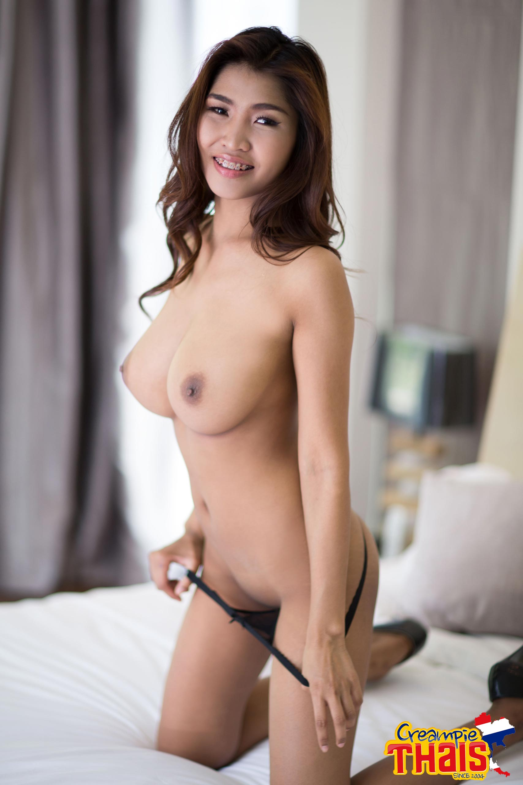 asian big tits braces - Titiporn is a young Thai girl, only 18yo with braces, removing her black  sheer bra and panties and spreading her legs, wouldn't you love to rock  your dick ...